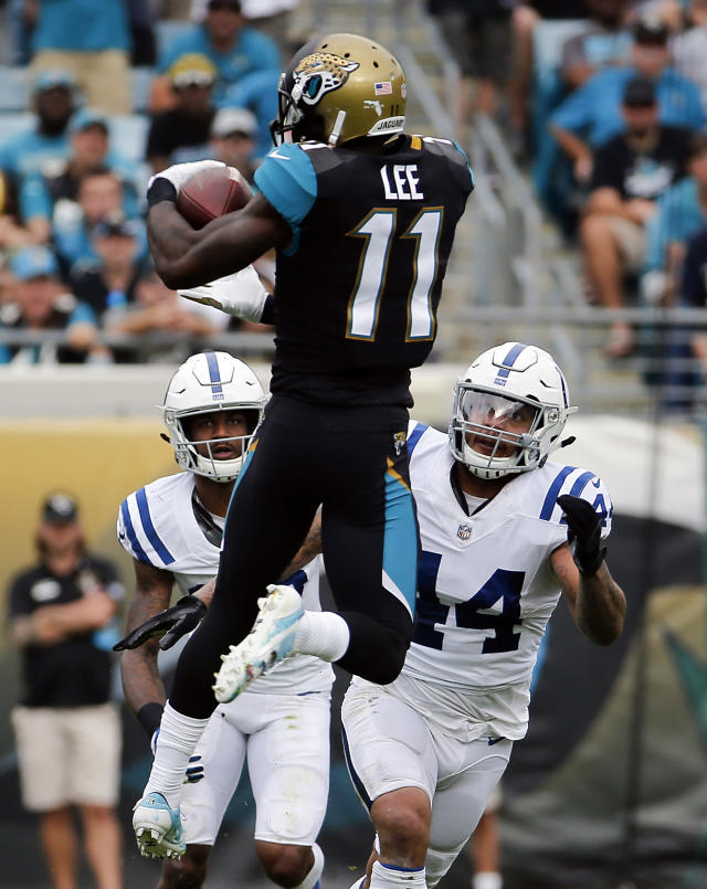 <p>Jacksonville Jaguars wide receiver Marqise Lee (11) makes a reception in front of Indianapolis Colts safety T.J. Green, left, and inside linebacker Antonio Morrison (44) during the first half of an NFL football game, Sunday, Dec. 3, 2017, in Jacksonville, Fla. (AP Photo/Stephen B. Morton) </p>