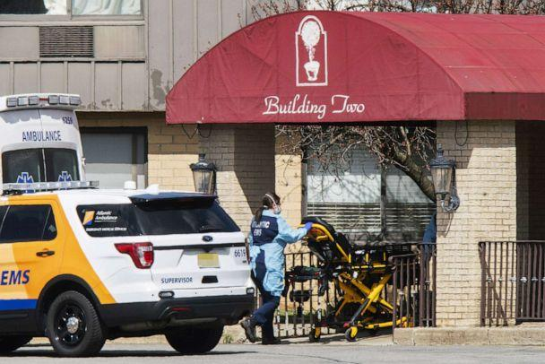 PHOTO: Medical workers prepare to transport a patient from Andover Subacute and Rehabilitation Center while wearing masks and personal protective equipment (PPE) on April 16, 2020 in Andover, N.J. (Eduardo Munoz Alvarez/Getty Images, FILE)