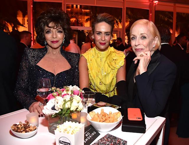 <p>Three's company: Collins crashed Paulson and Taylor's date night at the <em>Vanity Fair</em> party. (Photo: Kevin Mazur/VF18/WireImage) </p>