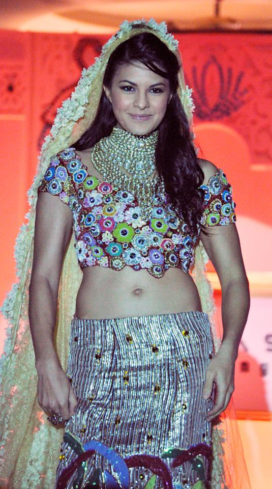 Jacqueline Fernandez takes part in a fashion show by designer Vikram Phadnis in Mumbai on May 9, 2010.