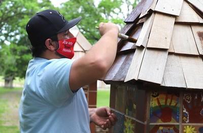 Wilde East Towne Honda in Madison, Wis. beautified Sun Prairie Dream Park for Week(s) of Service 2021. Here, volunteer Trevor Lipp helps out with some painting at the park.