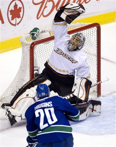 Vancouver Canucks left wing Chris Higgins (20) looks on as Anaheim Ducks goalie Jonas Hiller (1) makes a save during first period NHL hockey action at Rogers Arena in Vancouver, British Columbia, Tuesday, April, 3, 2012. (AP Photo/The Canadian Press, Jonathan Hayward)