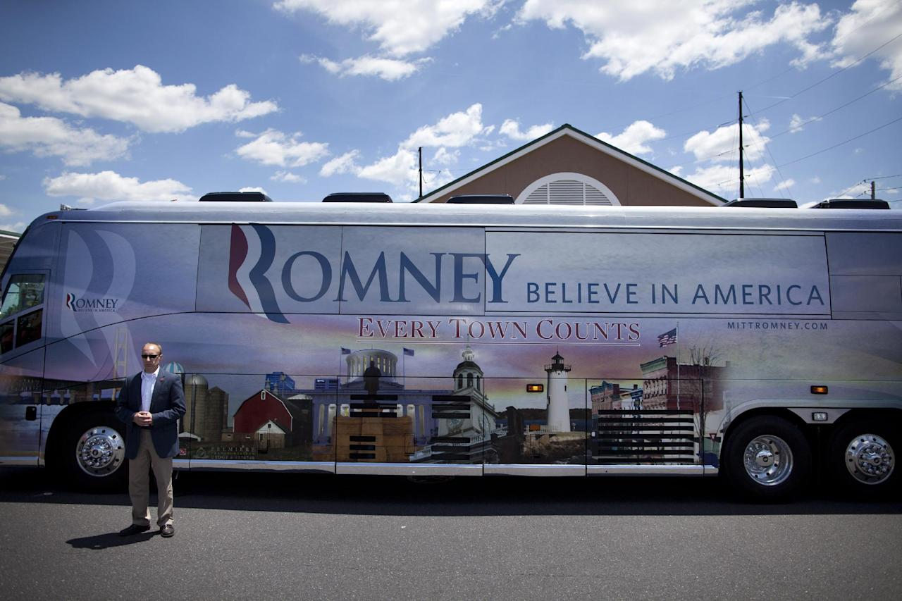 A Secret Service agent stands outside the bus of Republican presidential candidate, former Massachusetts Gov. Mitt Romney during a stop at Wawa gas station in in Quakertown, Pa. Saturday, June 16, 2012. (AP Photo/Evan Vucci)