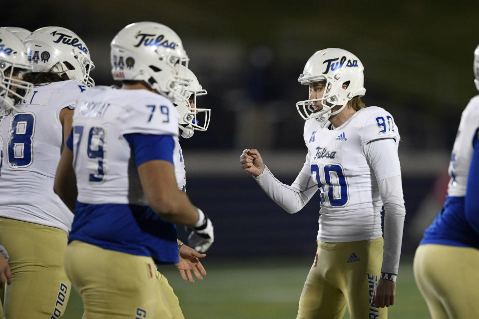 Tulsa place kicker Zack Long (90) celebrates his field goal during the first half of an NCAA college football game against Navy, Saturday, Dec. 5, 2020, in Annapolis, Md. (AP Photo/Nick Wass)