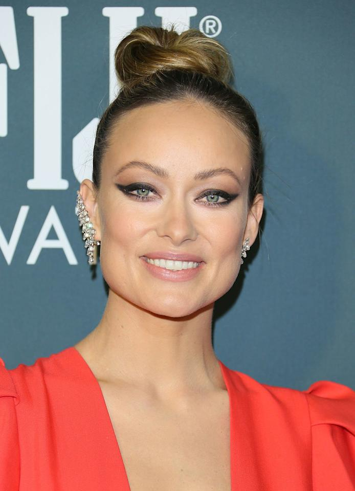 <p>Sleek and twisted up high on the crown of the head, Olivia Wilde's bun is the top knot you know and love. </p>