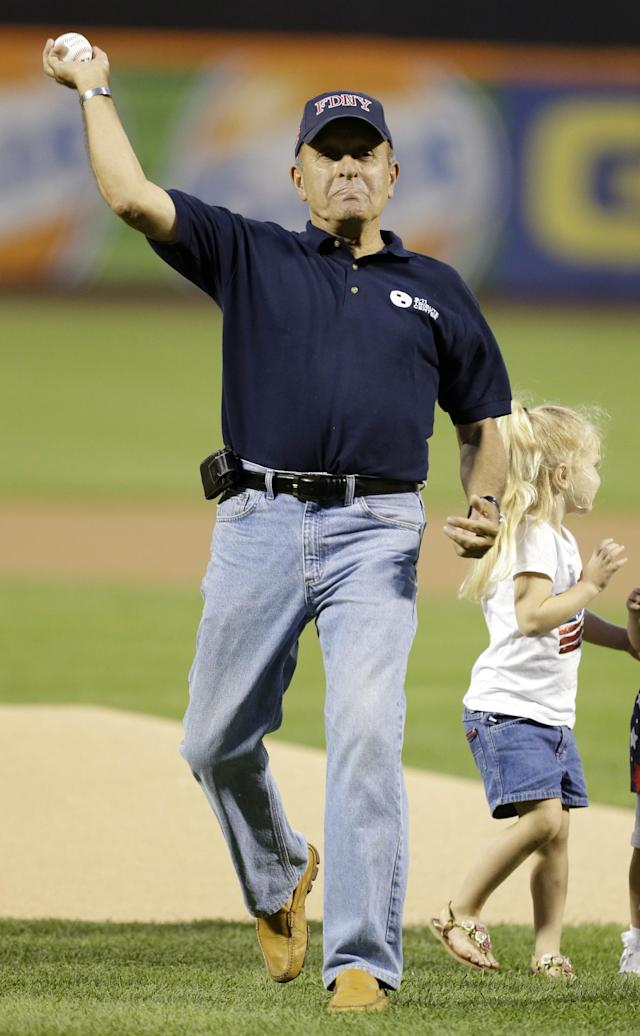 Lee Ielpi, president of the September 11 Families Association, throws out the ceremonial first pitch before a baseball game between the New York Mets and the Washington Nationals, Wednesday, Sept. 11, 2013, in New York. (AP Photo/Frank Franklin II)
