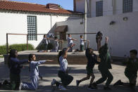 Students rehearse a dance at the St. Agnes Elementary School in Phoenix, Ariz., on March 3, 2020. In 2016, the student body at St. Agnes was two-thirds Hispanic; the figure is now 95%, and virtually every student receives financial aid through state-approved tax credit programs that extend to private schools. (AP Photo/Dario Lopez-MIlls)