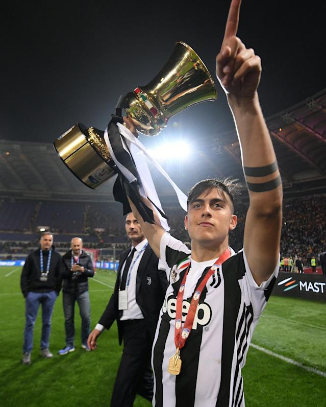 Soccer Football - Coppa Italia Final - Juventus vs AC Milan - Stadio Olimpico, Rome, Italy - May 9, 2018 Juventus' Paulo Dybala celebrates with the trophy after winning the Coppa Italia REUTERS/Alberto Lingria