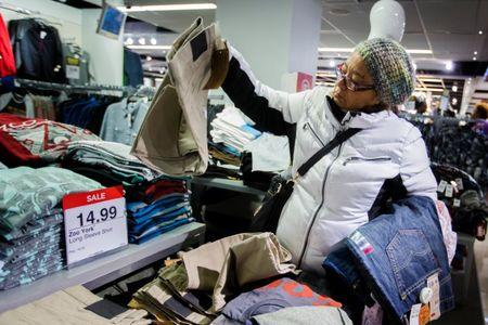 FILE PHOTO: A shopper looks at items on sale inside of a JC Penney store during Black Friday sales in New York, November 29, 2013. REUTERS/Lucas Jackson/File Photo