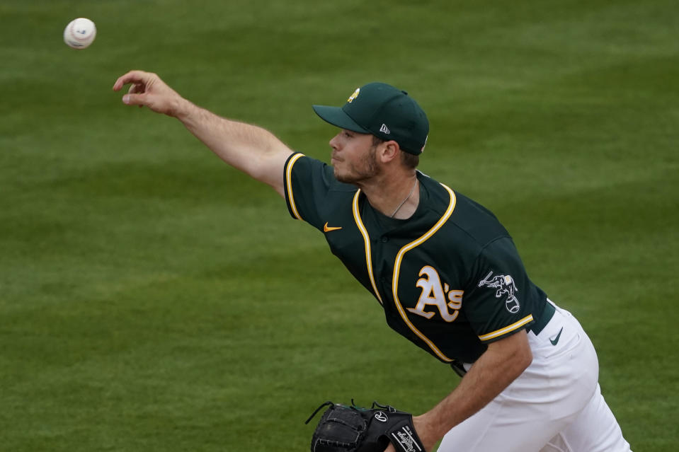 Oakland Athletics starting pitcher Daulton Jefferies throws against the Colorado Rockies during the second inning of a spring training baseball game, Tuesday, March 23, 2021, in Mesa, Ariz. (AP Photo/Matt York)