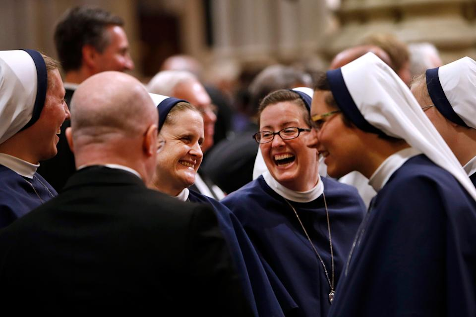 A group of nuns laugh inside St. Patrick's Cathedral as they wait for Pope Francis to lead an evening prayer service, Thursday, Sept. 24, 2015, in New York. (AP Photo/Jason DeCrow)