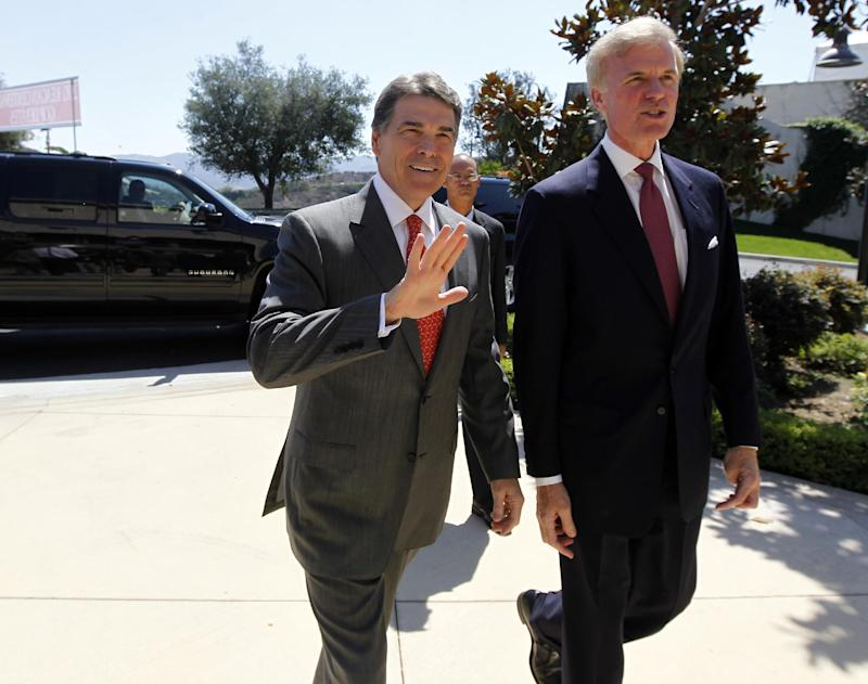 Republican president candidate Texas Gov. Rick Perry, left, is met by Frederick J. Ryan, Jr., chairman of the Ronald Reagan President Foundation, as he arrives for a Republican presidential debate at the Reagan Library Wednesday, Sept. 7, 2011, in Simi Valley, Calif.  (AP Photo/Chris Carlson)