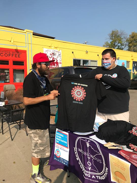 Activists wear masks at a recent gathering in Minneapolis' American Indian Cultural Corridor to register Native Americans to vote this election. Nearly half of the nearly 3 million eligible Native American voters are not yet registered.