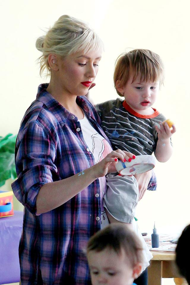 "Christina Aguilera enjoys making crafts with son Max at Color Me Mine. Clint Brewer/<a href=""http://www.splashnewsonline.com"" target=""new"">Splash News</a> - June 18, 2009"