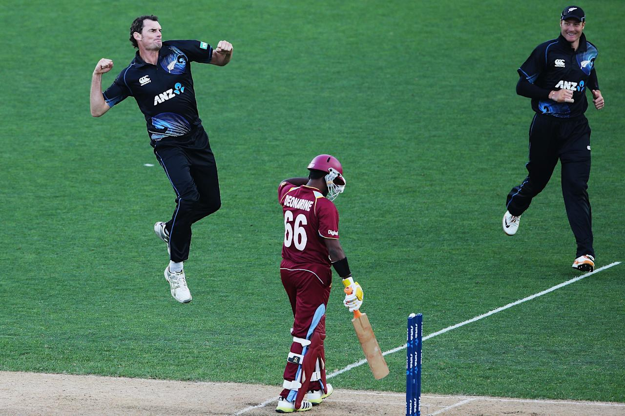 AUCKLAND, NEW ZEALAND - DECEMBER 26:  Kyle Mills of New Zealand celebrates the wicket of Narsingh Deonarine of the West Indies during the first One Day International match between New Zealand and the West Indies at Eden Park on December 26, 2013 in Auckland, New Zealand.  (Photo by Hannah Johnston/Getty Images)