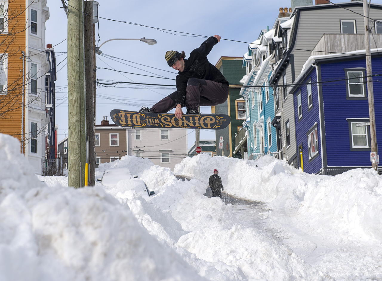 A snowboarder takes advantage of prime conditions in St. John's on Sunday, Jan. 19, 2020. The state of emergency ordered by the City of St. John's continues, leaving businesses closed and vehicles off the roads in the aftermath of the major winter storm that hit the Newfoundland and Labrador capital. THE CANADIAN PRESS/Andrew Vaughan