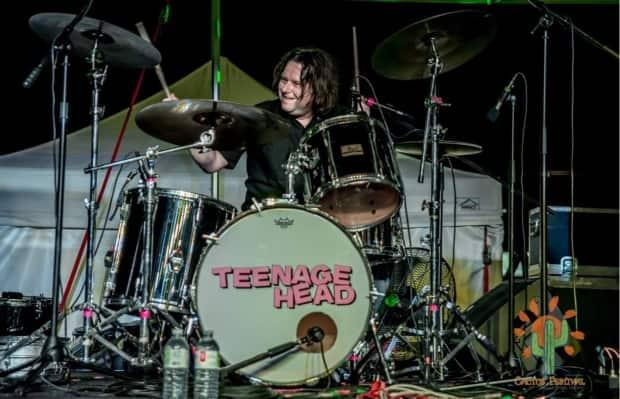 Gene Champagne, 52, a drummer for Teenage Head, the Killjoys and Tongue Fu, and frontman for his own band the Un-Teens, has reached out on social media to say he's now home and dreams of performing again soon. (Gene Champagne/Facebook. - image credit)
