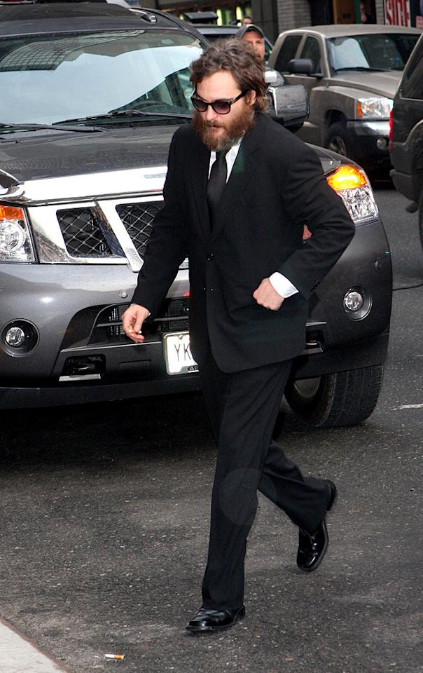 """Joaquin Phoenix's senses may have departed him during a bizarre interview on """"The David Letterman Show."""" Phoenix appeared dazed, swore, and stuck his gum beneath Letterman's desk. Some believe Phoenix's behavior is merely a stunt, especially since Casey Affleck is constantly following and filming him. Richie Buxo/<a href=""""http://www.splashnewsonline.com"""" target=""""new"""">Splash News</a> - February 11, 2009"""