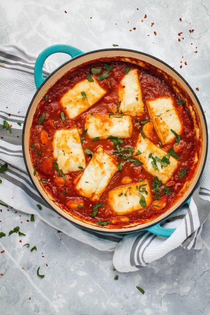 """<p>This recipe features halloumi and white beans baked in a rich, smoky, Spanish-inspired tomato sauce! It's the best one pot vegetarian meal that is on the table in just 30 minutes. </p><p>Get the <a href=""""https://www.happyveggiekitchen.com/halloumi-bake/"""" rel=""""nofollow noopener"""" target=""""_blank"""" data-ylk=""""slk:Smoky Tomato & Halloumi Bake"""" class=""""link rapid-noclick-resp"""">Smoky Tomato & Halloumi Bake</a> recipe.</p><p>Recipe from <a href=""""https://www.happyveggiekitchen.com/"""" rel=""""nofollow noopener"""" target=""""_blank"""" data-ylk=""""slk:Happy Veggie Kitchen"""" class=""""link rapid-noclick-resp"""">Happy Veggie Kitchen</a>.</p>"""