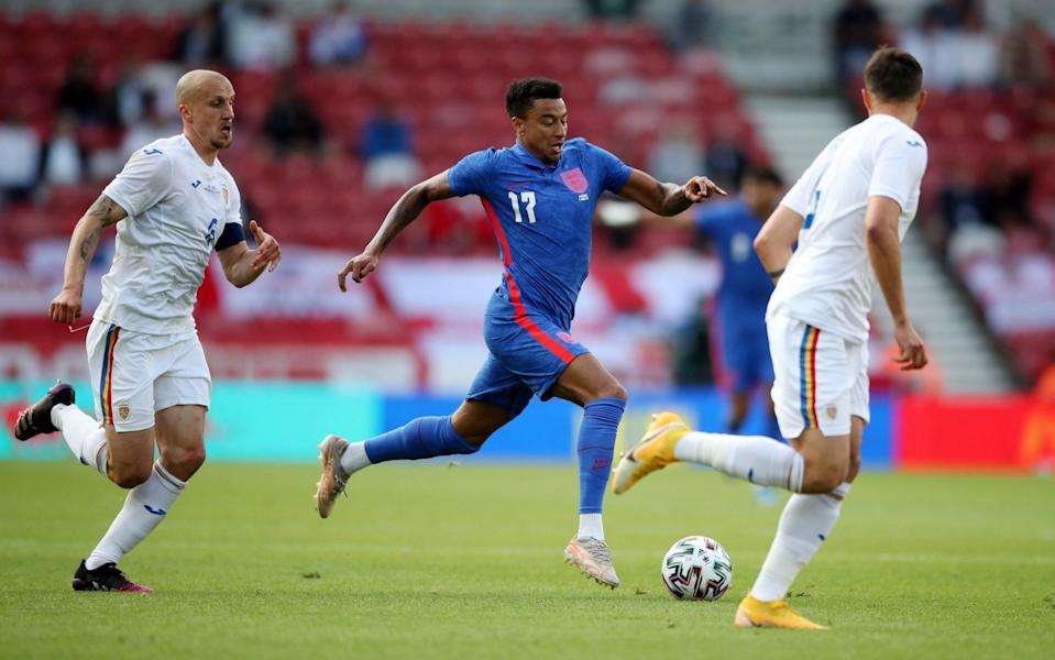 Jesse Lingard is supporting England from afar this summer despite appearing in their warm-up friendlies against Austria and Romania - REUTERS