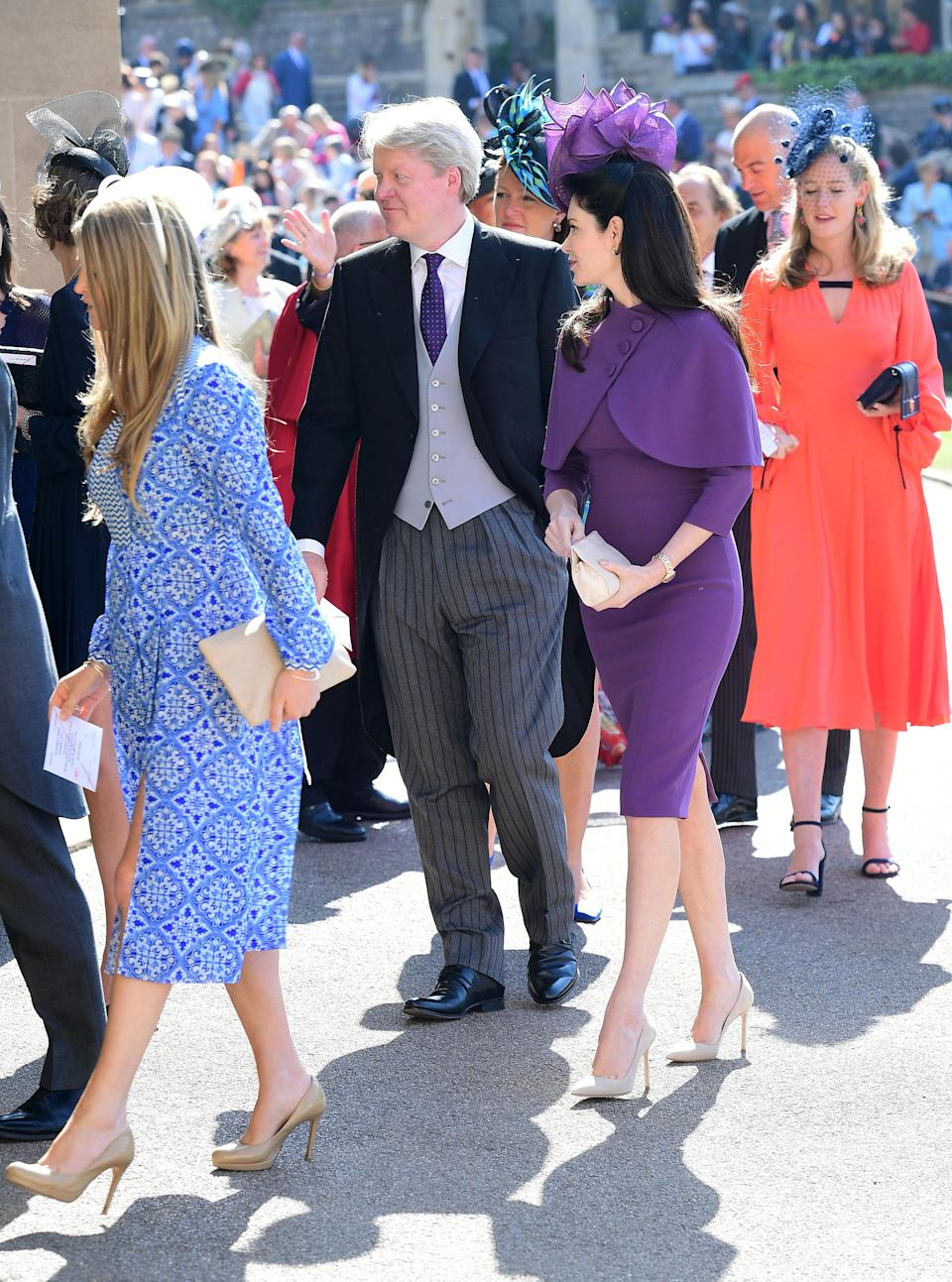 <p>Lady Diana's younger brother opts for a regal purple tie, perfectly co-ordinating with his wife. <em>[Photo: PA]</em> </p>