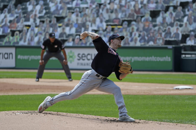 Cleveland Indians starting pitcher Zach Plesac throws the ball against the Chicago White Sox during the first inning of a baseball game in Chicago, Saturday, Aug. 8, 2020. (AP Photo/Nam Y. Huh)