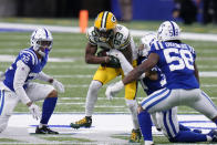 Green Bay Packers' Marquez Valdes-Scantling (83) is tackled by Indianapolis Colts' Khari Willis (37) during the second half of an NFL football game, Sunday, Nov. 22, 2020, in Indianapolis. (AP Photo/AJ Mast)