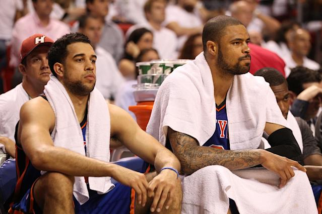 MIAMI, FL - MAY 09: Tyson Chandler (R) and Landry Fields of the New York Knicks sit on the bench against the Miami Heat in Game Five of the Eastern Conference Quarterfinals in the 2012 NBA Playoffs on May 9, 2012 at the American Airines Arena in Miami, Florida. Miami defeated the Knicks 106-94 to advance to the next round four games to one. NOTE TO USER: User expressly acknowledges and agrees that, by downloading and or using this photograph, User is consenting to the terms and conditions of the Getty Images License Agreement. (Photo by Marc Serota/Getty Images)