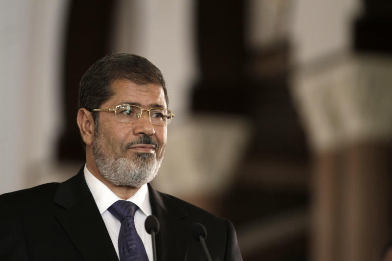 FILE - In this Friday, July 13, 2012 file photo, Egyptian President Mohammed Morsi holds a joint news conference with Tunisian President Moncef Marzouki at the presidential palace in Cairo, Egypt. Morsi had his first extensive meeting with lawyers, Tuesday, Nov. 12, 2013, consulting in prison with a team from his Muslim Brotherhood over his ongoing trial on charges of inciting murder. So far, Morsi is refusing to accept any legal representation in the trial, insisting he remains president, and his son says he wants to take legal action against those prosecuting him after his ouster by the military.(AP Photo/Maya Alleruzzo, File)
