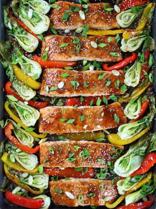 Rich salmon can stand up to a sticky honey-lime glaze and roasts up with veggies in this fast dinner.
