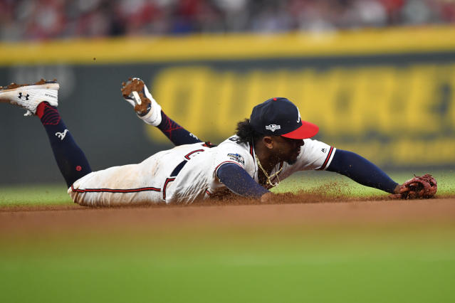 Atlanta Braves center fielder Ronald Acuna Jr. (13) can't get his glove on a ball hit by St. Louis Cardinals third baseman Tommy Edman in the ninth inning during Game 1 of a best-of-five National League Division Series, Thursday, Oct. 3, 2019, in Atlanta. (AP Photo/John Amis)