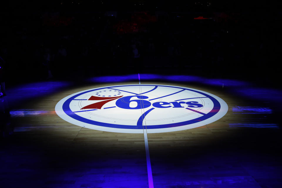 The Philadelphia 76ers' lhalf-court logo is shown before an NBA basketball game against the Cleveland Cavaliers, Friday, Nov. 8, 2013, in Philadelphia. (AP Photo/Matt Slocum)