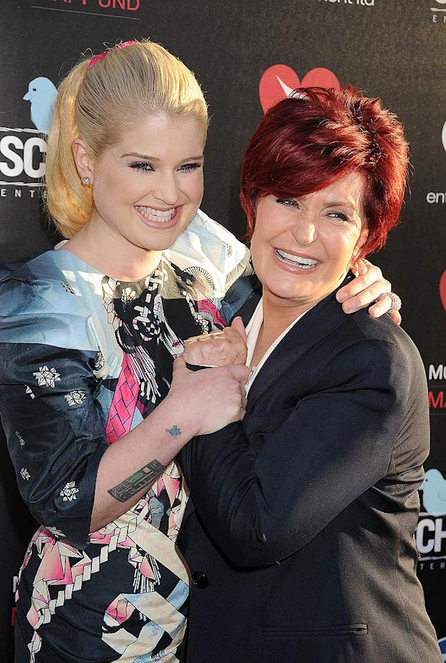 "Kelly Osbourne and her mom, Sharon, were all smiles on Monday night when they showed up to celebrate the main man in their lives -- Ozzy -- at a screening of the documentary film ""God Bless Ozzy Osbourne."" The event, which took place at the iconic Arclight theater in Hollywood, benefited the Musicares Map Fund. Jeffrey Mayer/<a href=""http://www.wireimage.com"" target=""new"">WireImage.com</a> - August 22, 2011"