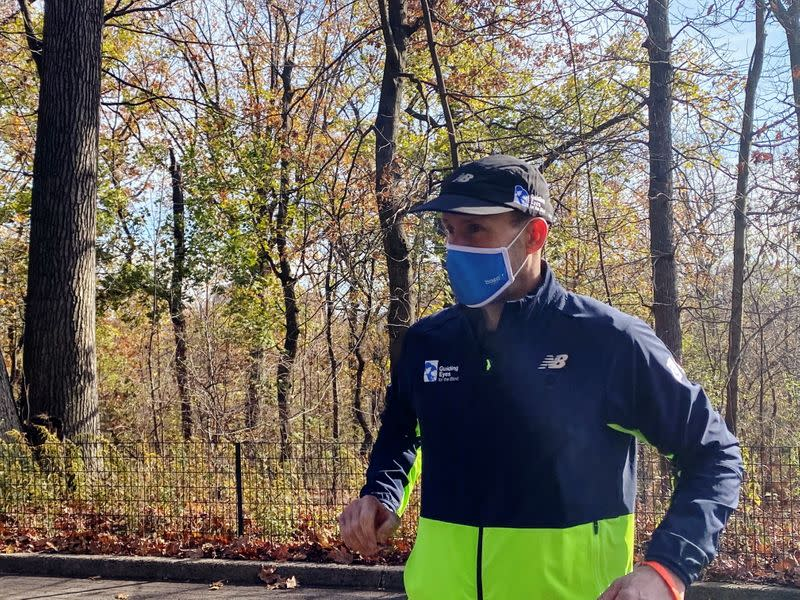"Thomas Panek, a blind runner and CEO of Guiding Eyes for the Blind, gets ready for a 5K run in Central Park where he will use Google's ""Guideline"" app instead of help from a human or guide dog, in New York"