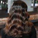 "Brown ale hair has a deep mahogany base and swirls of amber highlights. ""It's different from traditional brunettes because of the richness and the depth it provides,"" colorist <a href=""https://www.instagram.com/colincaruso/"" rel=""nofollow noopener"" target=""_blank"" data-ylk=""slk:Colin Caruso"" class=""link rapid-noclick-resp"">Colin Caruso</a> tells <em>Glamour.</em> ""It's warm without the brassy or mousy undertones some people associate with traditional brunettes."" He says the shade is perfect for this time of year since it's a great way to go deeper and richer for the cold weather ahead while still offering a touch of warmth."