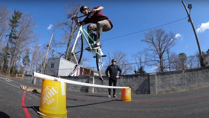 """A team of BMXers created a """"pogo bike"""" and used it for a deceivingly dangerous parking lot obstacle course."""