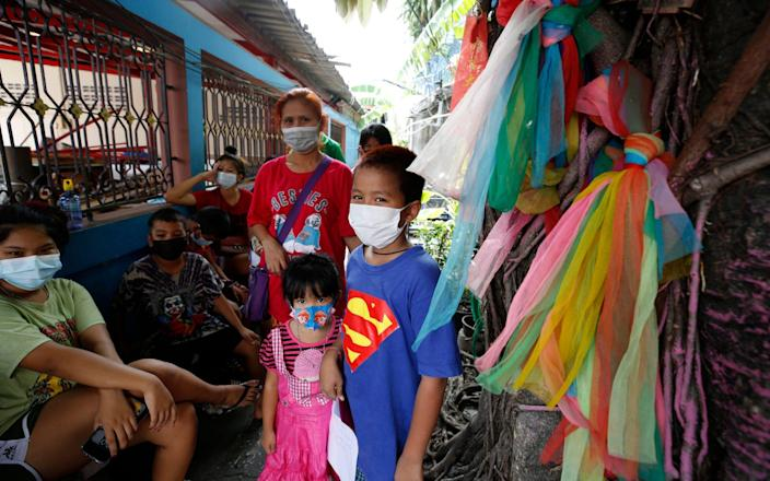 Thai people wait to undergo a nasal swab to test for Covid-19 - Narong Sangnak/EPA-EFE/Shutterstock