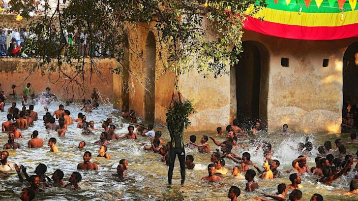 Ethiopian Orthodox Christians bathe in the Fasilides baths during the Timkat festival in Gondar on 19 January 2014.