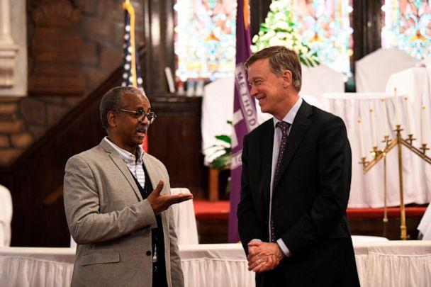 PHOTO: Former Colorado Gov. John Hickenlooper discusses gun control and death penalty issues with Anthony Thompson on April 6, 2019, in Charleston, S.C. (Meg Kinnard/AP, FILE)