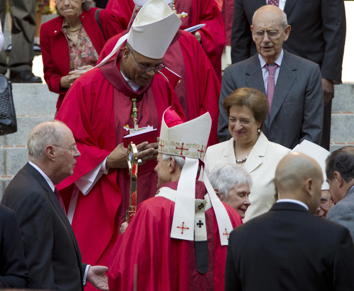 Cardinal Archbishop of Washington Donald Wuerl, bottom center, speaks with U.S. Supreme Court Justice Anthony Kennedy, left, as Justices Elena Kagan, center right, and Stephen Breyer, top right, all talk on the steps of the Cathedral of St. Matthew the Apostle after the 60th annual Red Mass at in Washington on Sunday Sept. 30, 2012. The Red Mass is held traditionally in Washington the day before the Supreme Court's new term opens. (AP Photo/Jose Luis Magana)