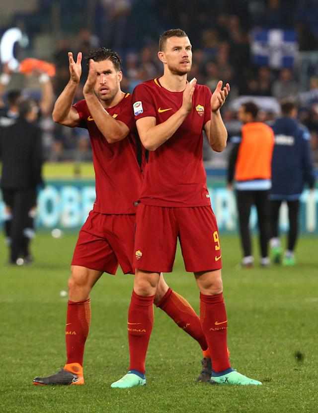 Soccer Football - Serie A - Lazio vs AS Roma - Stadio Olimpico, Rome, Italy - April 15, 2018 Roma's Edin Dzeko and Kevin Strootman applaud the fans at the end of the match REUTERS/Alessandro Bianchi