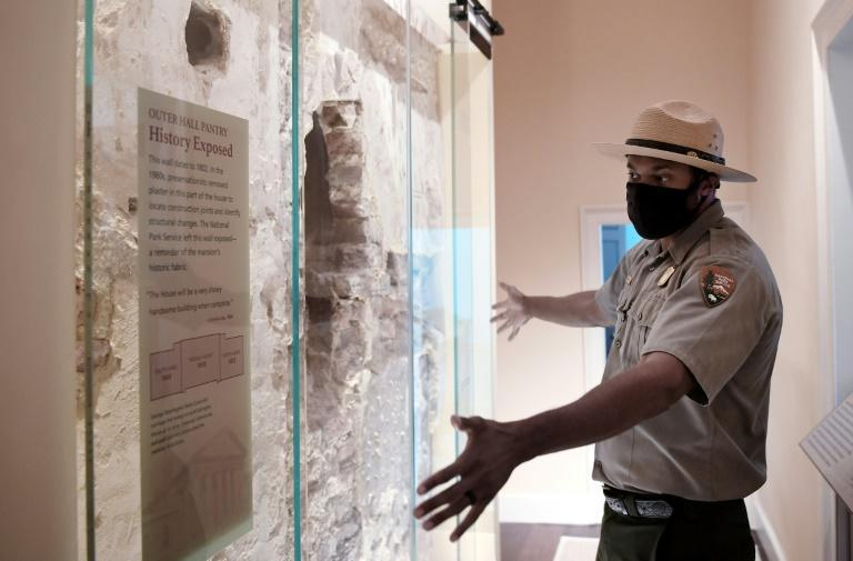 Park Ranger Aaron LaRocca shows an original wall from 1802 on display inside Arlington House (AFP/Olivier DOULIERY)