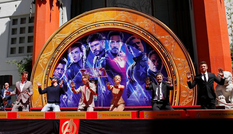 """LOS ANGELES, April 24, 2019 -- Actors Chris Hemsworth, Chris Evans, Robert Downey Jr., actress Scarlett Johansson, actors Mark Ruffalo, Jeremy Renner From L to R attend their print ceremony in the forecourt of the TCL Chinese Theater in Los Angeles, the United States, April 23, 2019. The cast of Marvel Studios """"Avengers: Endgame"""" including Robert Downey Jr., Chris Evans, Mark Ruffalo, Chris Hemsworth, Scarlett Johansson, and Jeremy Renner, along with Marvel Studios President Kevin Feige, received one of Hollywood's oldest accolades this Tuesday, to sign their names and put their handprints in cement at the TCL Chinese Theater IMAX in Hollywood. (Xinhua/Li Ying) (Xinhua/ via Getty Images)"""