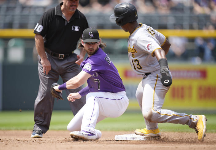 Colorado Rockies shortstop Brendan Rodgers, left, fields the throw as Pittsburgh Pirates' Ke'Bryan Hayes steals second base in the third inning of a baseball game Wednesday, June 30, 2021, in Denver. (AP Photo/David Zalubowski)