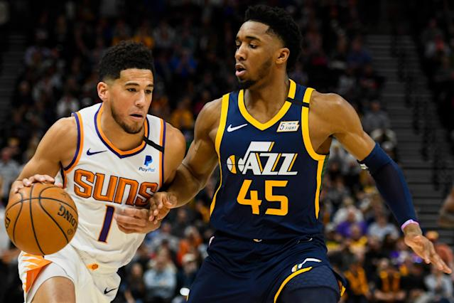 Devin Booker had a good day online. Donovan Mitchell, less so. (Photo by Alex Goodlett/Getty Images)