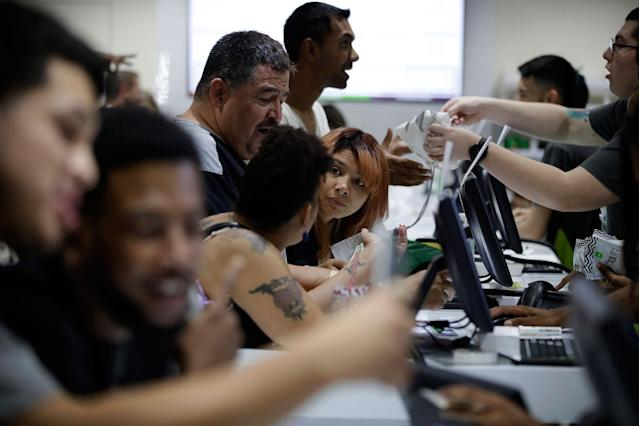 <p>People buy marijuana products at the Essence cannabis dispensary, Saturday, July 1, 2017, in Las Vegas, Nev. (Photo: John Locher/AP) </p>