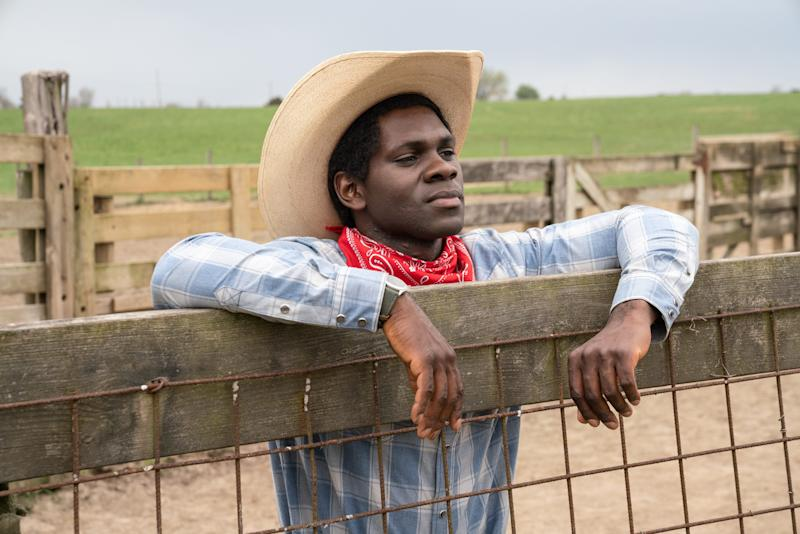 Nigerian immigrant Igwe (Conphidance) attempts to assimilate to American culture by buying a cowboy hat and boots.