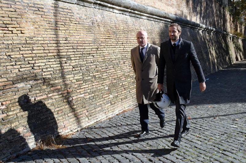 Journalists Gianluigi Nuzzi (L) and Emiliano Fittipaldi arrive at the Vatican on November 24, 2015 before the opening of the trial for the publication of classified documents that mired the Holy See into scandal (AFP Photo/Andreas Solaro)