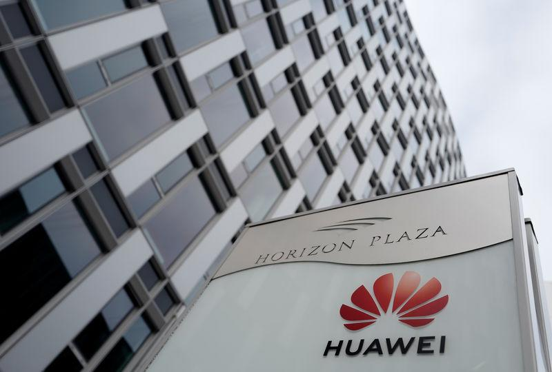 FILE PHOTO: Logo of Huawei is seen in front of the local offices of Huawei in Warsaw