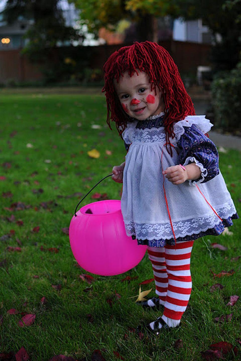 """<p>Raggedy Ann? More like Adorable Ann! (Sorry. We had to.)</p><p><strong>Get the tutorial at <a href=""""http://prettylittlebuzz.blogspot.com/2011/11/wordless-wednesday-halloween-recap.html"""" rel=""""nofollow noopener"""" target=""""_blank"""" data-ylk=""""slk:Pretty Little Buzz"""" class=""""link rapid-noclick-resp"""">Pretty Little Buzz</a>.</strong></p><p><strong><a class=""""link rapid-noclick-resp"""" href=""""https://www.amazon.com/Christmas-Holiday-Winter-Styles-Warmers/dp/B018ZV1ZOK/?tag=syn-yahoo-20&ascsubtag=%5Bartid%7C10050.g.4975%5Bsrc%7Cyahoo-us"""" rel=""""nofollow noopener"""" target=""""_blank"""" data-ylk=""""slk:SHOP LEG WARMERS"""">SHOP LEG WARMERS</a></strong></p>"""